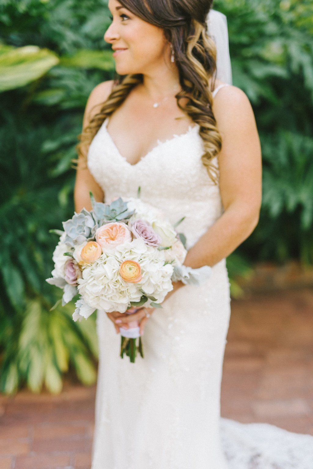Outdoor Florida Bride Wedding Portrait in V Neck Lace Fitted and Spaghetti Strap Wedding Dress with White Hydrangeas, Blush Pink and Succulent Floral Bouquet | St. Pete Beach Photographer Kera Photography | Hair and Makeup Michele Renee the Studio