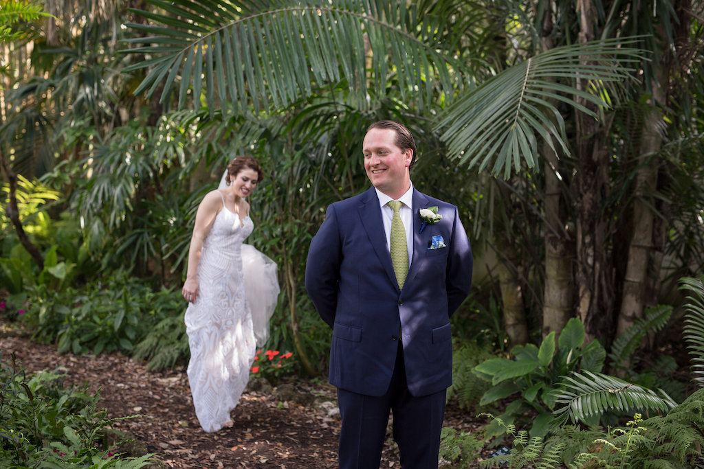 Outdoor Florida Garden Bride and Groom First Look Wedding Portrait | Tampa Bay Photographer Cat Pennenga Photography| Sarasota Wedding Venue Marie Selby Botanical Gardens