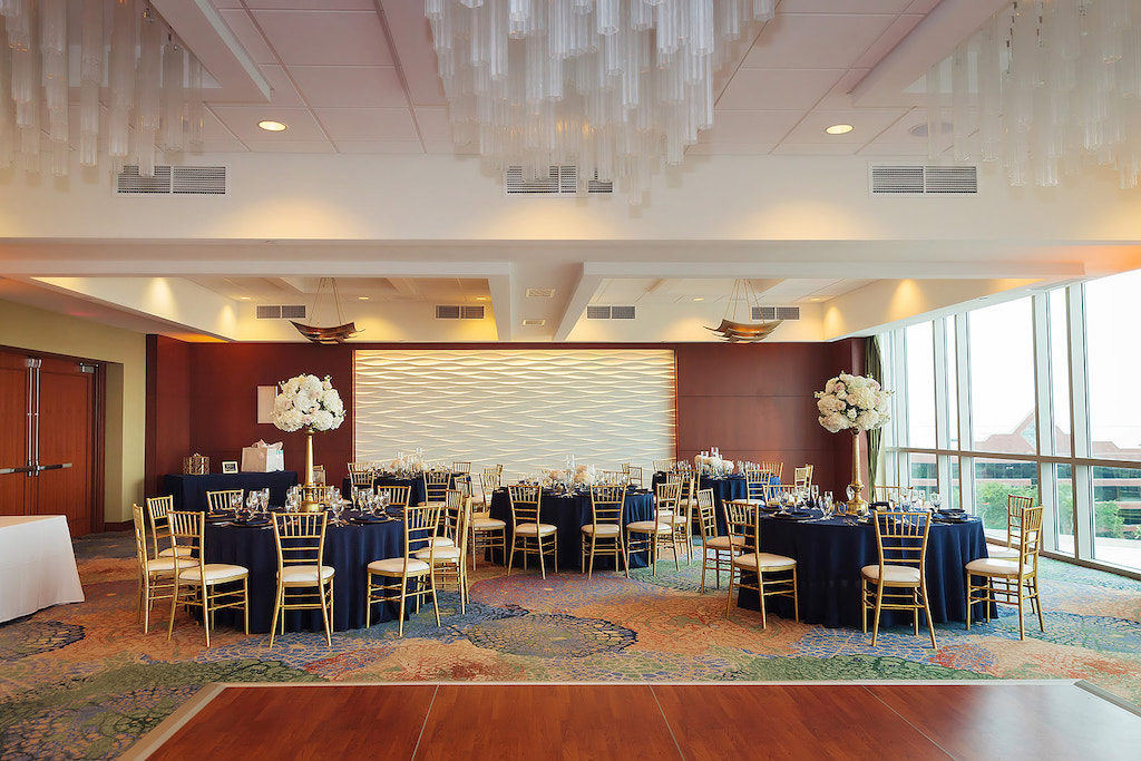 Ballroom Wedding Reception Decor, Round Tables with Navy Blue Tablecloths, Gold Chiavari Chairs, Tall Gold Vase with Ivory Floral Centerpieces |Tampa Bay Wedding Venue The Westin Tampa Bay
