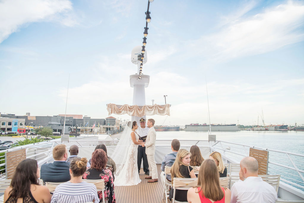 Florida Bride and Groom Wedding Ceremony Portrait on Deck of Tampa Waterfront Venue Yacht Starship II | Tampa Bay Wedding Photographer Kristen Marie Photography