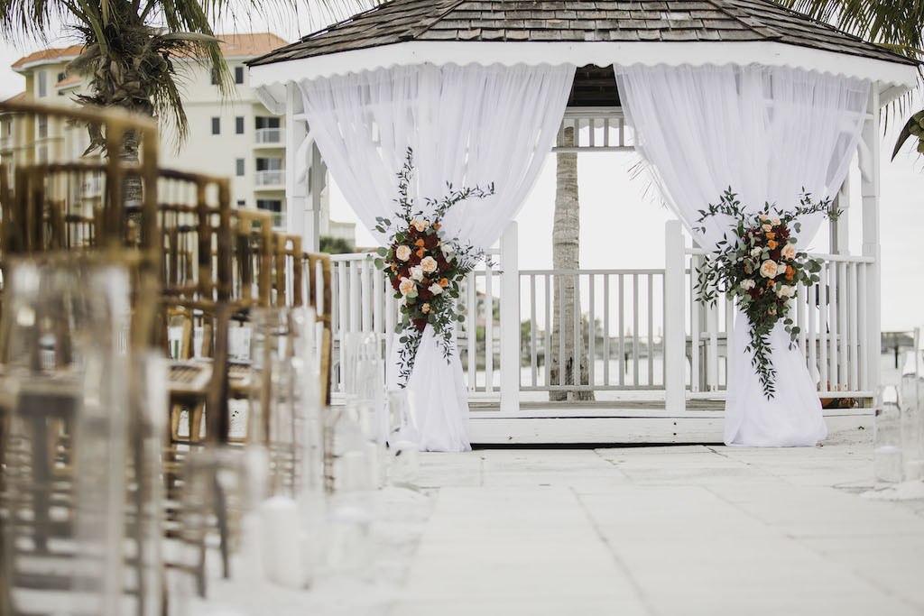 Outdoor Beach Wedding Ceremony at Gazebo with White Draping and Colorful Floral Bouquets | Waterfront St. Petersburg Venue Isla Del Sol Yacht and Country Club