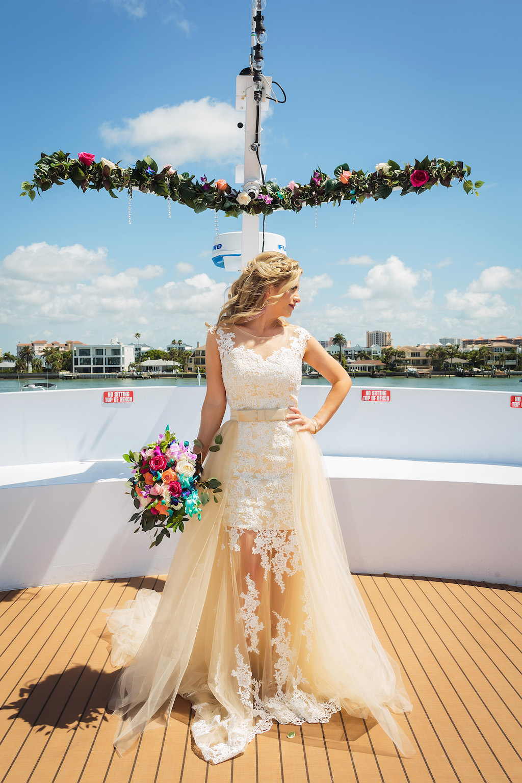 Florida Bride Wedding Portrait on Deck of Yacht, Bride in Lace and Illusion with Tulle Train High Scoop Neckline with Satin Champagne Bow Belt with Colorful Floral Bridal Bouquet | Florida Bride and Groom Wedding Portrait on Deck of Yacht, Bride in Lace and Illusion with Tulle Train High Scoop Neckline Wedding Dress with Colorful Floral Bridal Bouquet, Groom in Navy Blue Tuxedo | Unique Waterfront Tampa Wedding Venue The Yacht Starship IV | Tampa Bay Hair and Makeup Femme Akoi