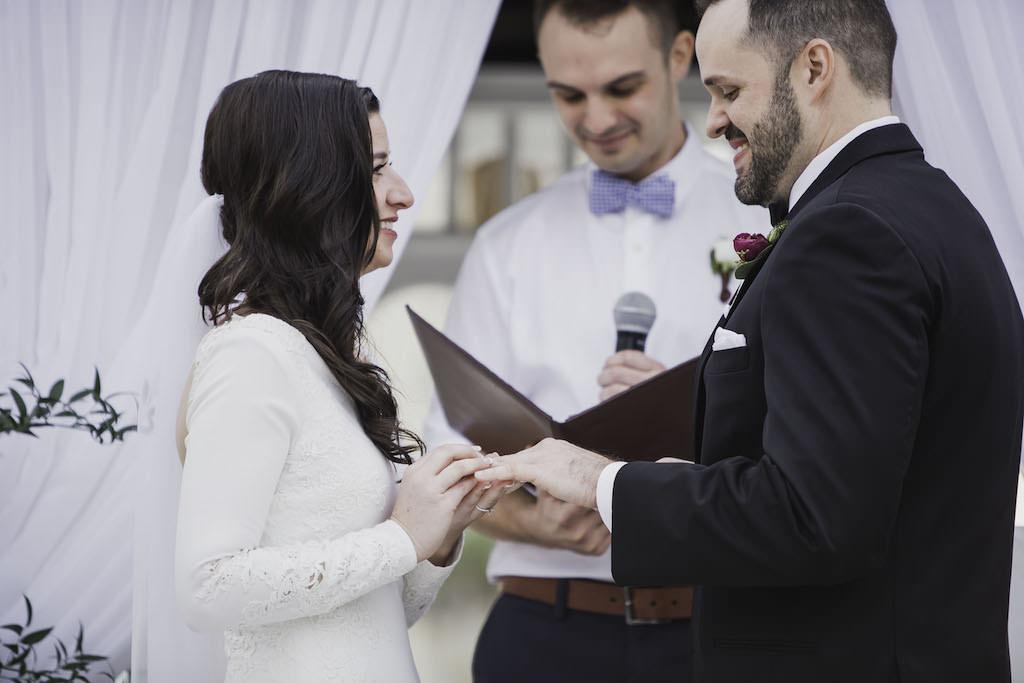 Outdoor Florida Beach Wedding Ceremony Portrait Bride and Groom Exchanging Vows