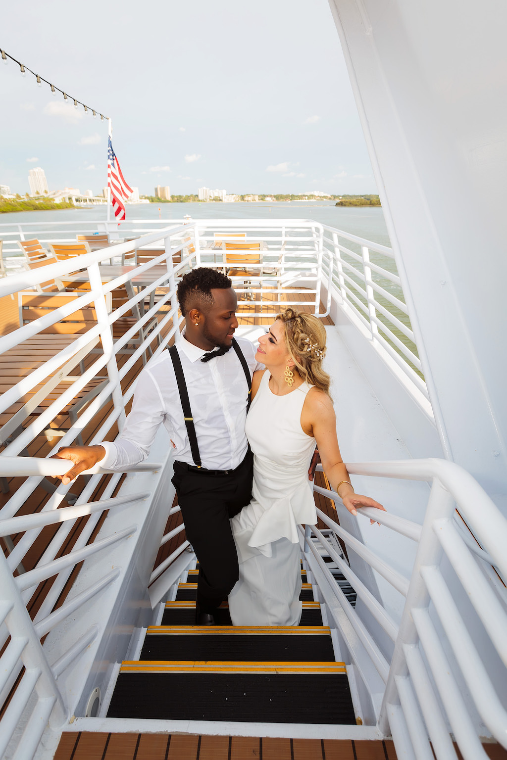 Florida Bride and Groom Wedding Portrait on Staircase of Unique Waterfront Tampa Wedding Venue The Yacht Starship IV