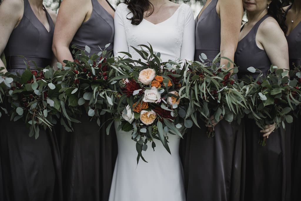 Outdoor Florida Bride and Bridesmaids Wedding Portrait, Bride in Crepe and Lace Mermaid Long Sleeve Wedding Dress with Cathedral Veil, Bridesmaids in Matching Halter Top Grey Long Dresses with Greenery, Blush Pink, Orange and Red Floral Bouquets