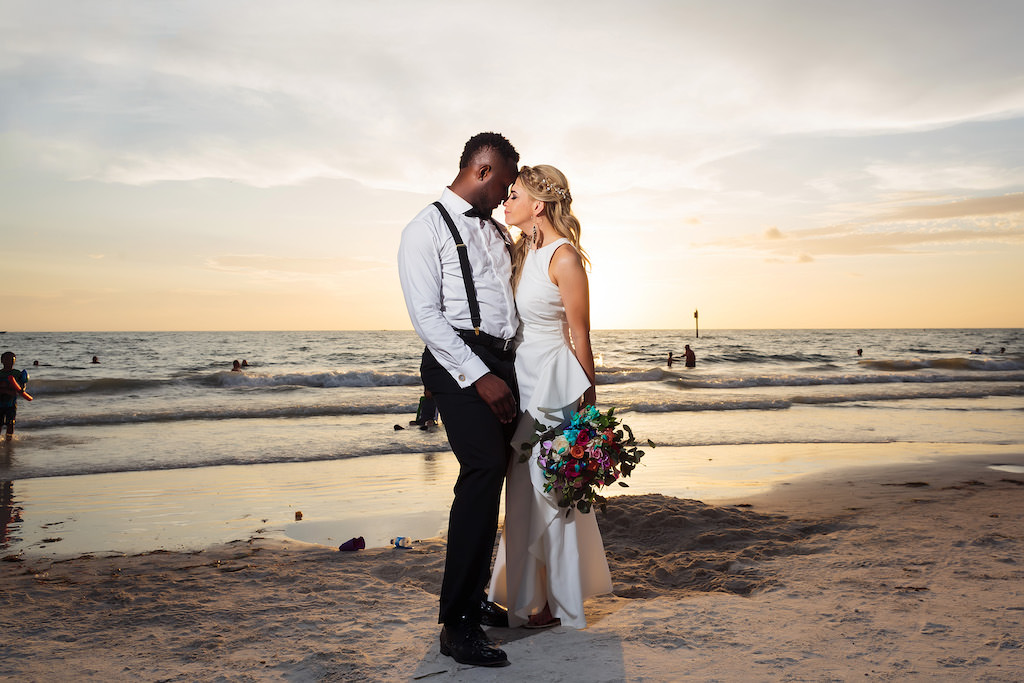 Florida Sunset Bride and Groom Wedding Portrait on Beach, Bride in Halter Neckline Cascading Ruffle at Front with Colorful Floral Bouquet