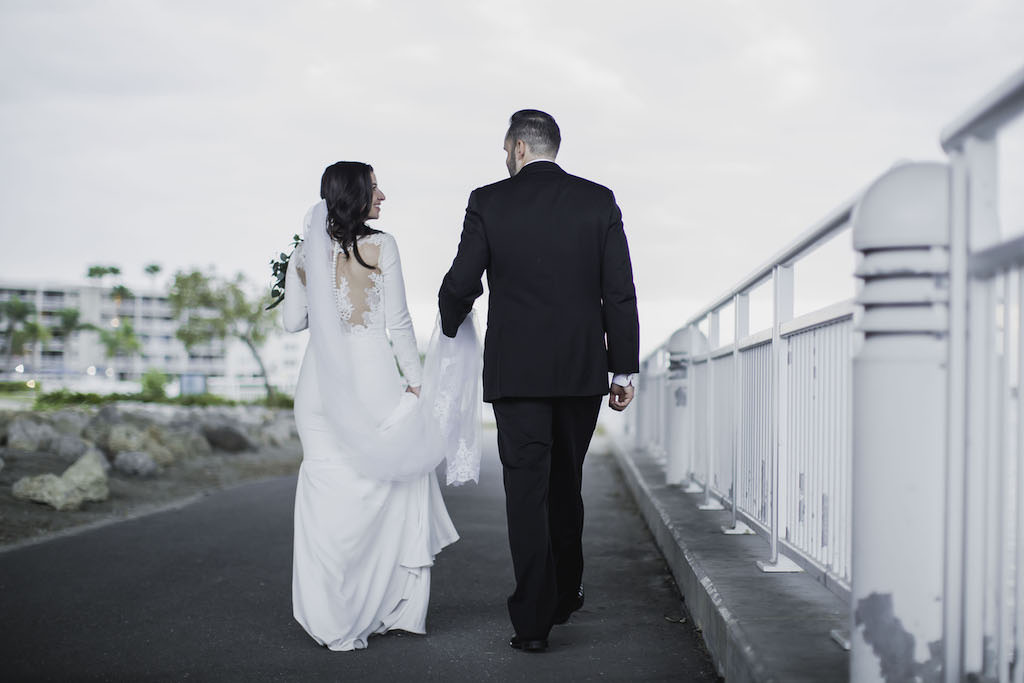 Outdoor Florida Bride and Groom Wedding Portrait, Groom Holding Bride's Cathedral Veil