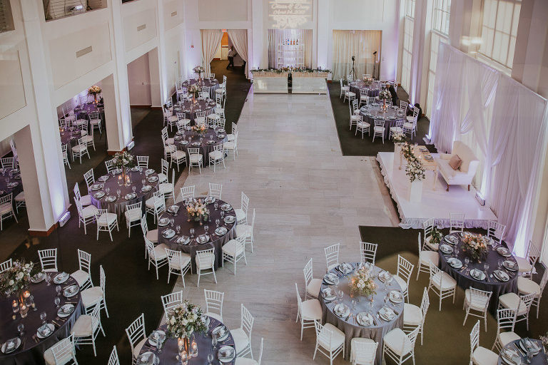 Modern Wedding Reception with Silver Chiavari Chairs and Round Tables with Purple Linens at Downtown Tampa Wedding Venue The Vault | Tampa Bay Wedding Photographer Brandi Image Photography
