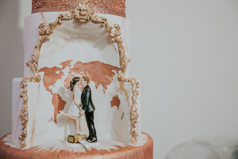 Elegant, Unique White and Rose Gold Wedding Cake with Cutout Designed with Rose Gold World Map and Vintage Gold Decorative Outlining, Bride and Groom Figurines | Tampa Bay Wedding Photographer Brandi Image Photography | Tampa Wedding Cakes The Artistic Whisk