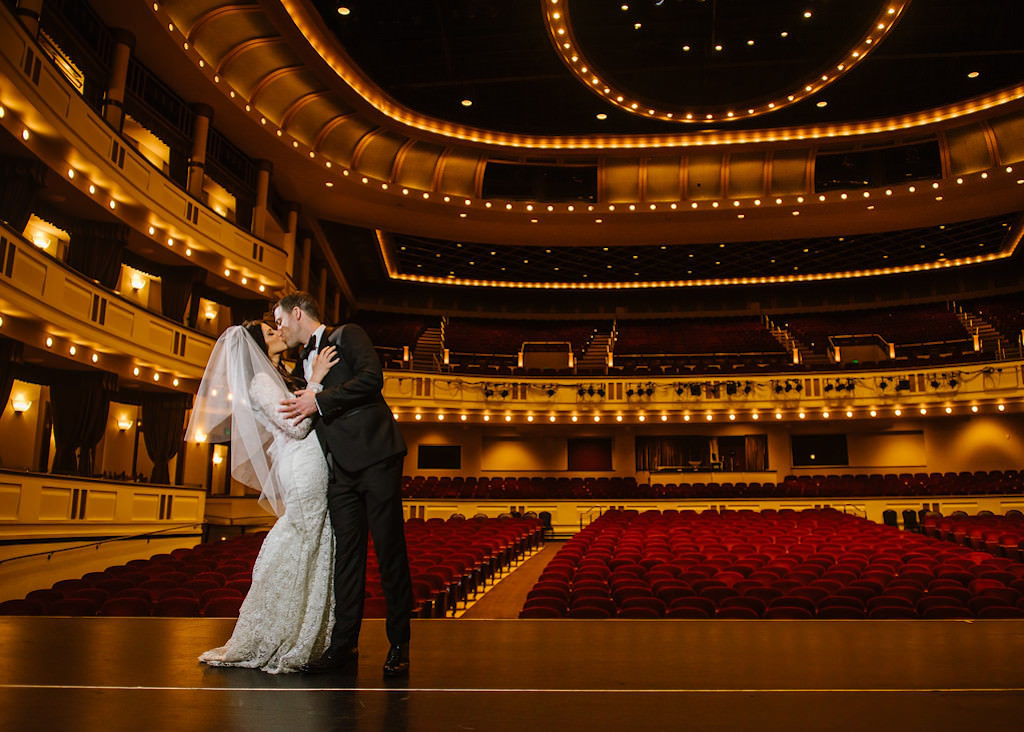 Bride and Groom Wedding Portrait on the Stage of Downtown St. Pete Wedding Venue the Mahaffey Theatre