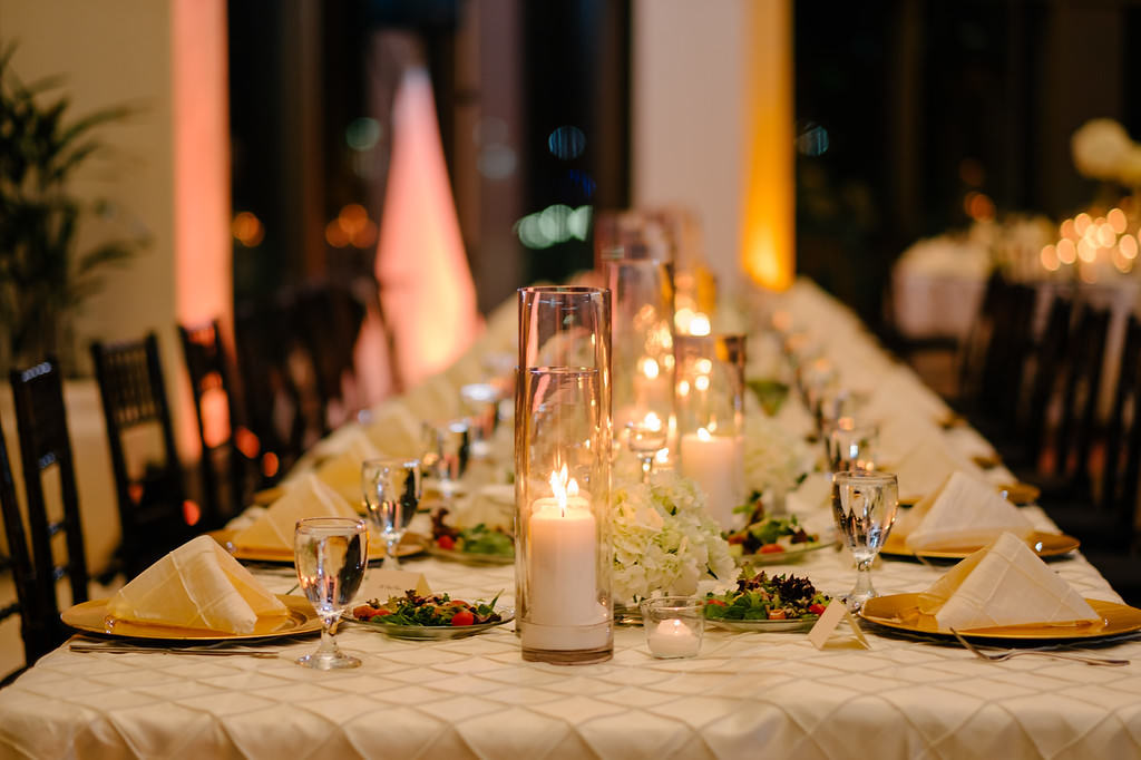Elegant, Timeless Traditional Candle Centerpieces with Gold Chargers and Pintuck Linens   Downtown St. Pete Wedding Venue the Mahaffey Theatre