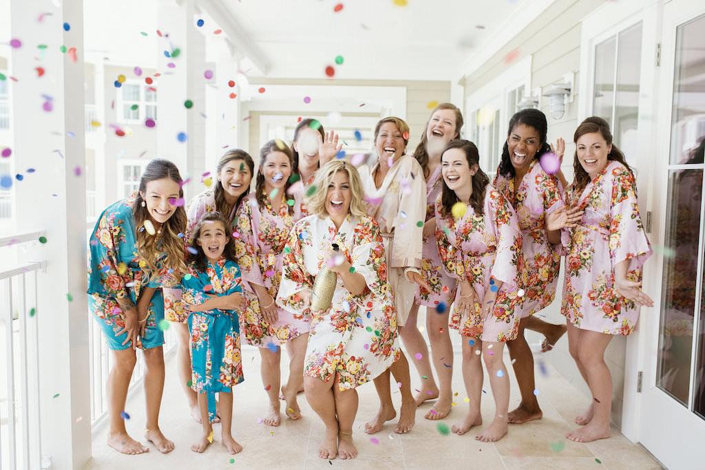 Florida Bride and Bridesmaids Wedding Getting Ready Confetti Portrait, Bridesmaids in Blush Pink Floral Print Robes and Blue Floral Print Robes