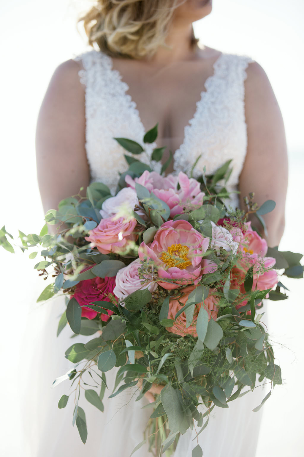 Florida Bride Beach Wedding Portrait with Tropical Inspired pink, Red, Coral and Greenery Floral Bouquet | Wedding Dress Shop Truly Forever Bridal