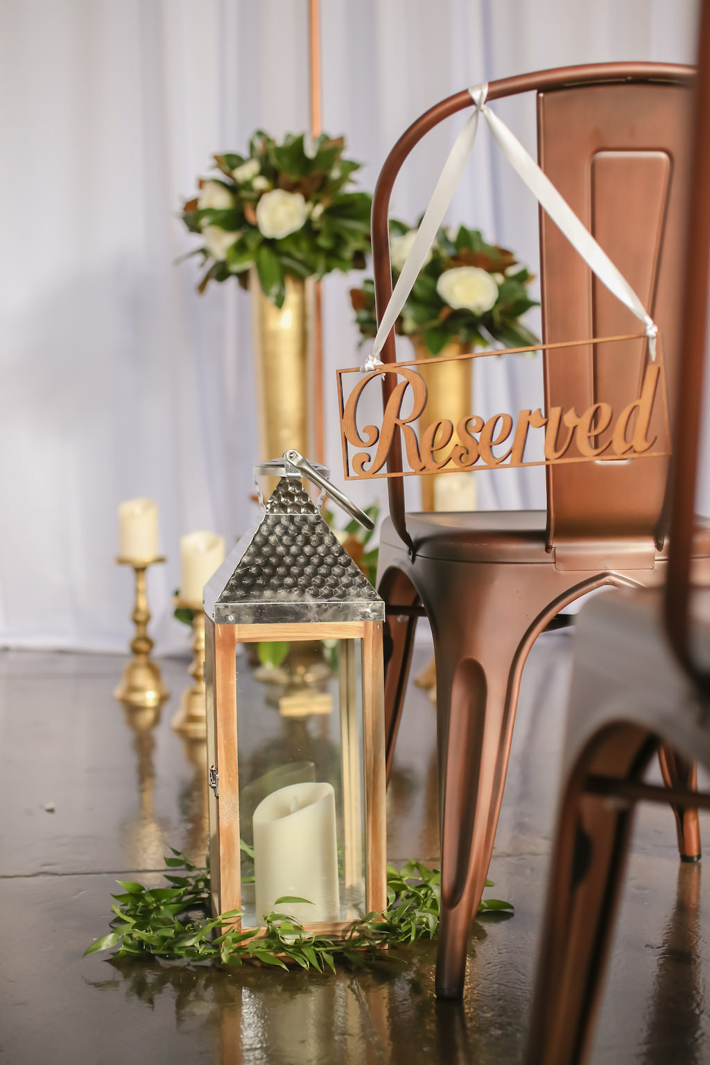 Industrial Inspired Wedding Ceremony Decor, Bronze Metal Chairs, Gold Lanterns with Greenery Wreath   Tampa Bay Wedding Photographer Lifelong Photography Studios   Wedding Rentals A Chair Affair