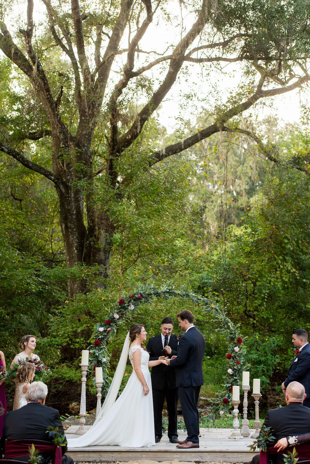 Florida Bride and Groom Exchanging Vows at Rustic Outdoor Garden Wedding Ceremony | Rustic Plant City Wedding Venue Kathleen's Garden