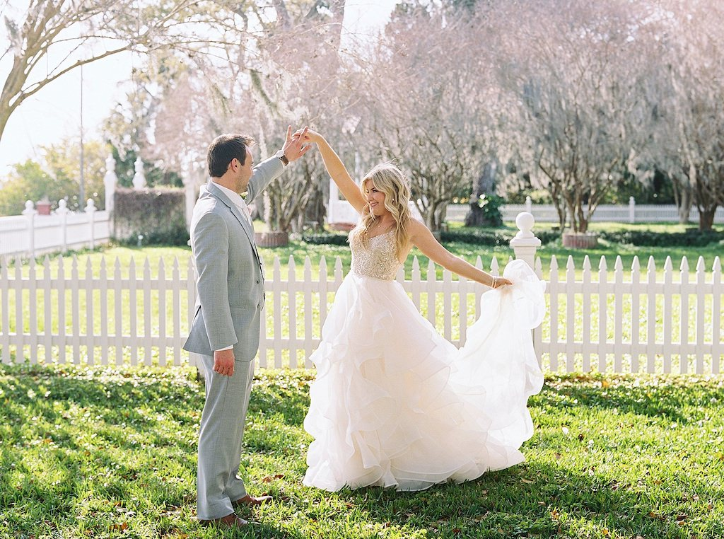 Florida Bride and Groom First Look Outdoor Wedding Portrait, Bride in Watter Nude and Rhinestone Embellished Spaghetti Strap Bodice and Tulle Flowy Skirt Ballgown Wedding Dress, Groom in Grey Suit