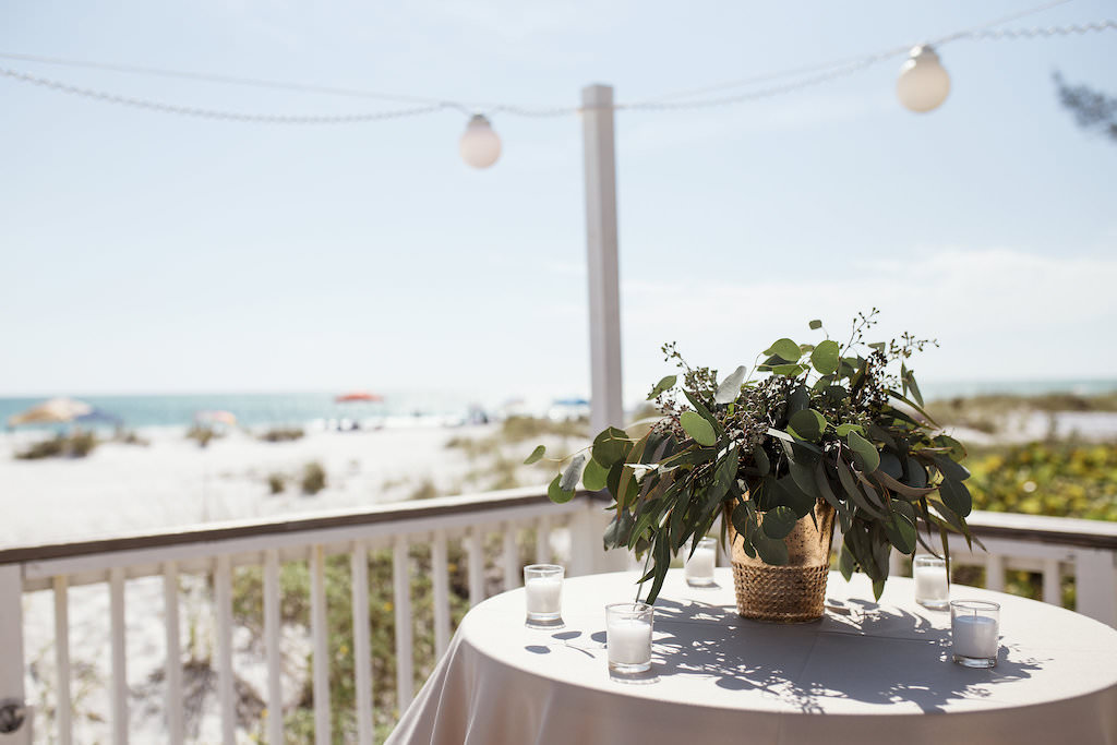 Tropical Beach Wedding Decor, High Round Cocktail Table with Taupe Tablecloth, Gold Vase and Greenery Florals