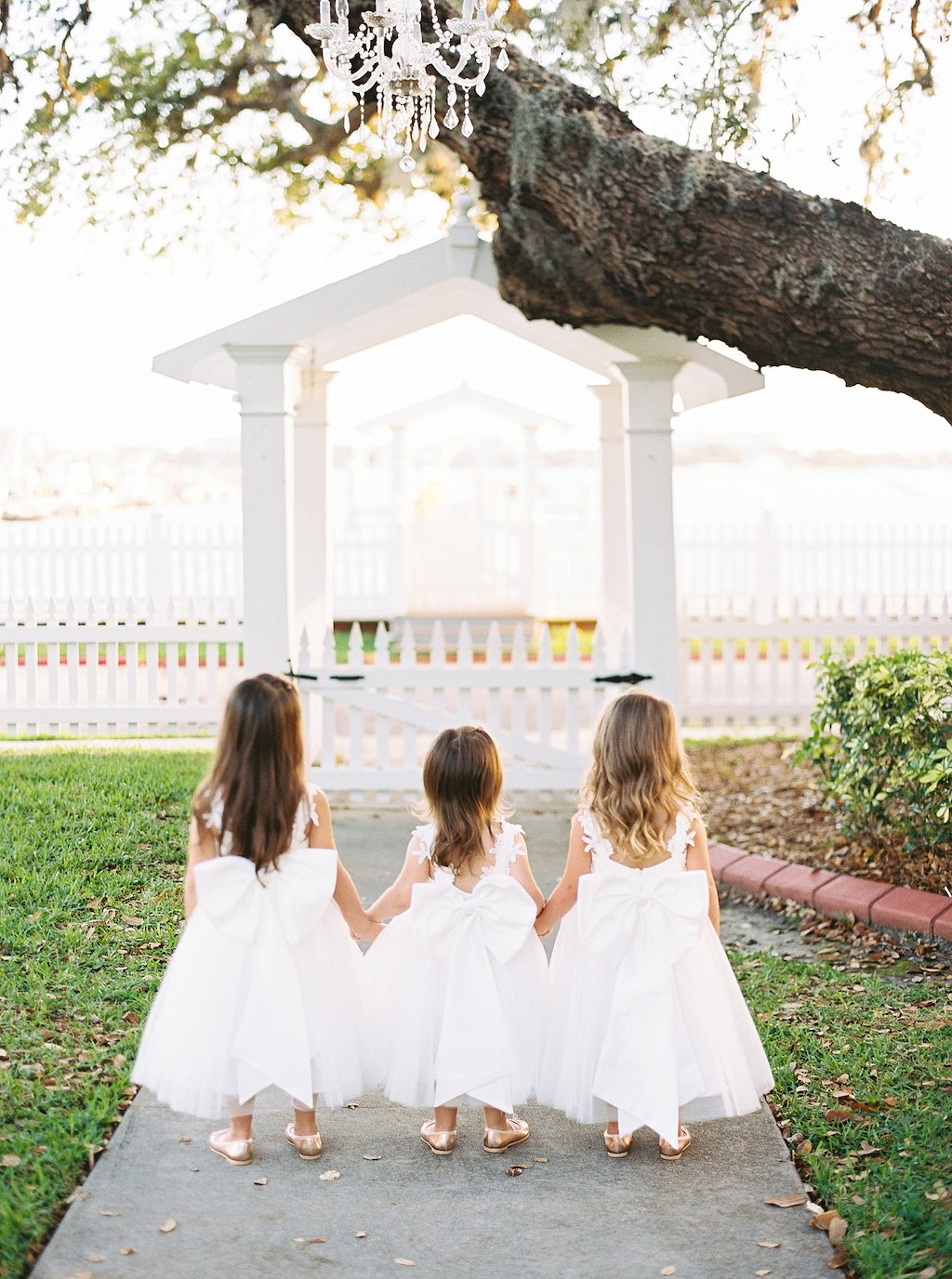Flowergirls in White Dresses with Big Bows | Florida Wedding Venue Palmetto Riverside Bed and Breakfast