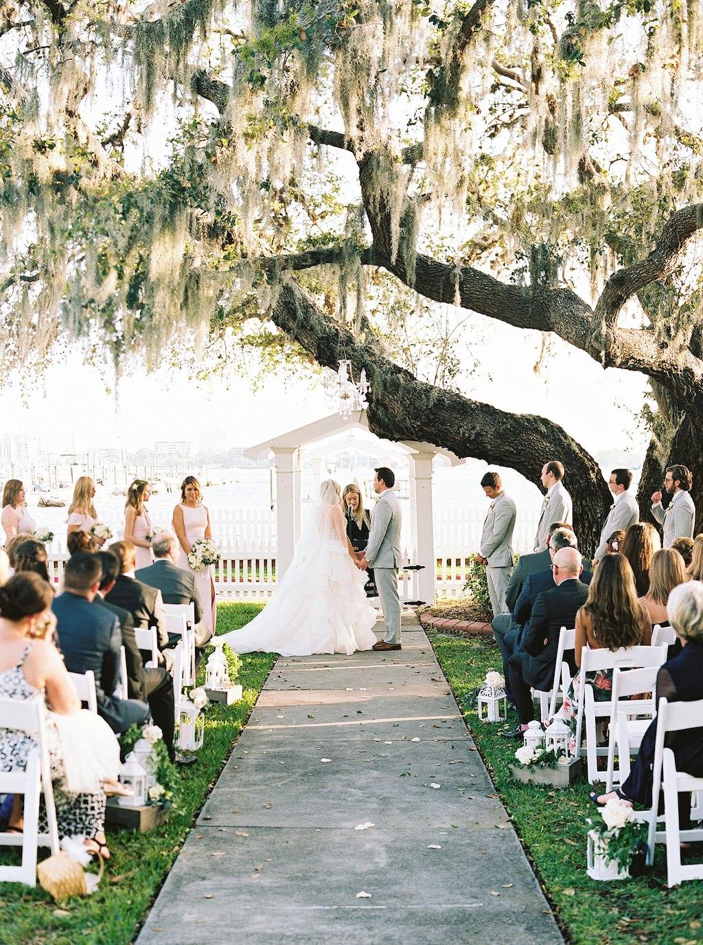 Florida Bride and Groom Waterfront Outdoor Wedding Portrait Exchanging Vows | Florida Wedding Venue Palmetto Riverside Bed and Breakfast