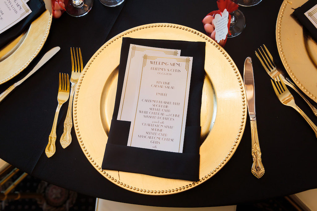 Black and Gold Vintage 1920's Great Gatsby Inspired Wedding Reception with Gold Chargers