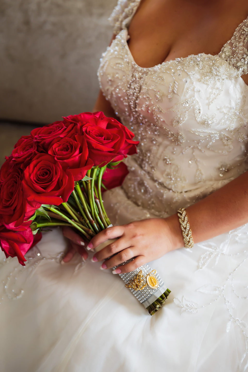 Sweetheart Cut Wedding Dress with Lace Sleeves and Red Rose Wedding Bouquet | Tampa Bay Bridal Shop Truly Forever Bridal