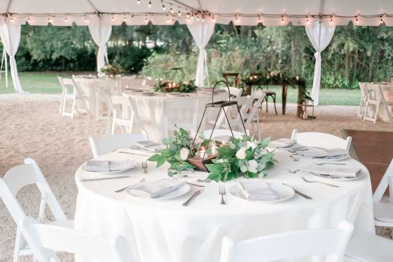 Nature Chic Inspired Tent Wedding Reception Decor, Round TABles with White Tablecloth, Geometric Centerpiece with Candles and Greenery and Ivory Roses | Wedding Planner Love Lee Lane | Tampa Bay Wedding Photographer Lifelong Photography Studio | Wedding Venue The Secret Garden at Paradise Spring