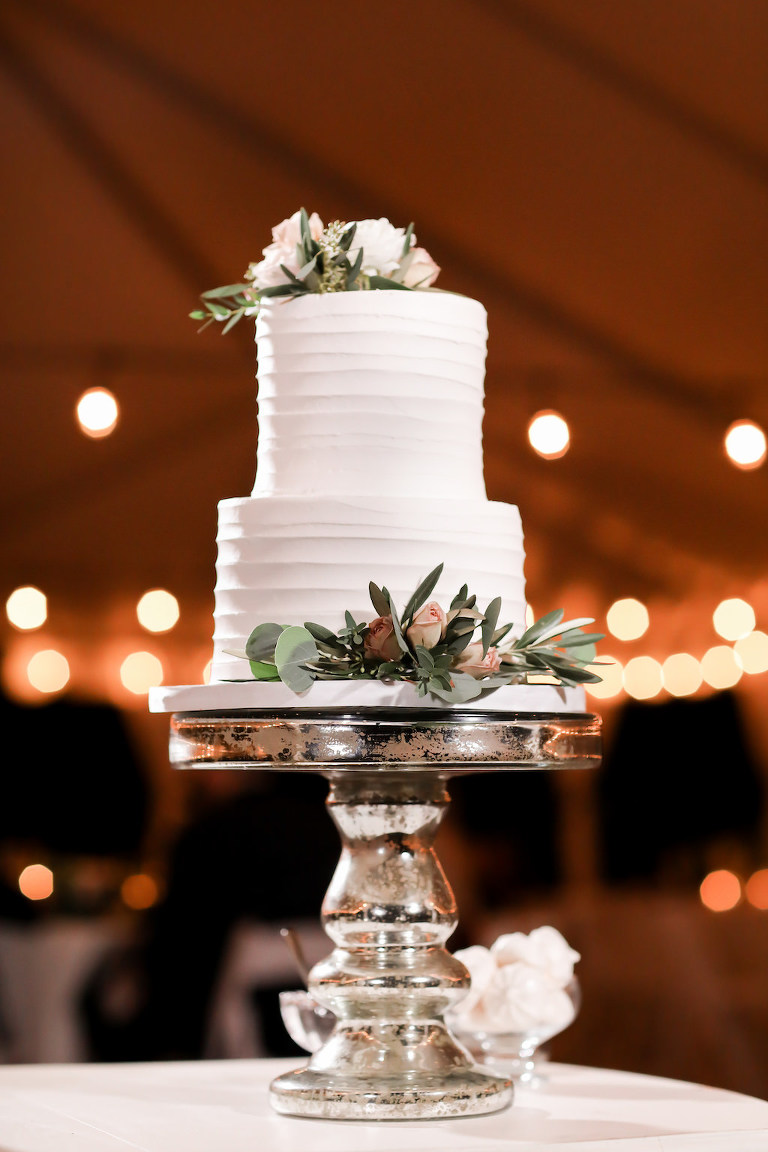 Simple Two Tier White Wedding Cake with Real Ivory, Greenery and Blush Pink Roses on Silver Mercury Cake Stand   Tampa Bay Wedding Photographer Lifelong Photography Studio   Wedding Planner Love Lee Lane   Wedding Cake Alessi Bakeries