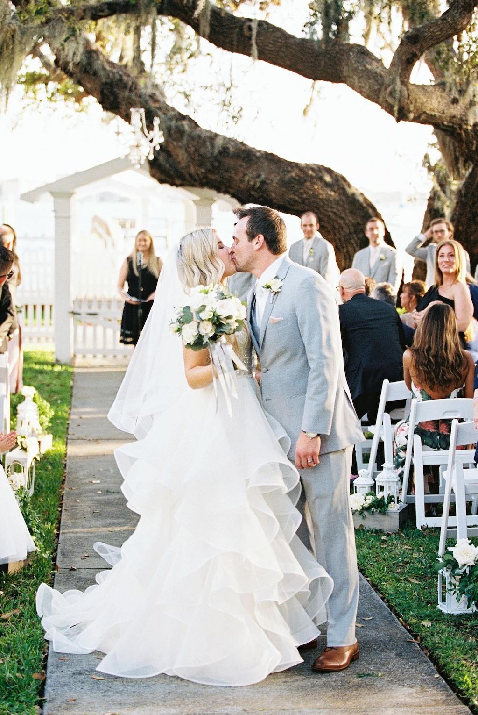Florida Bride and Groom Waterfront Outdoor Wedding Portrait Exiting Ceremony | Florida Wedding Venue Palmetto Riverside Bed and Breakfast | Tampa Bay Wedding Florist Cotton & Magnolia