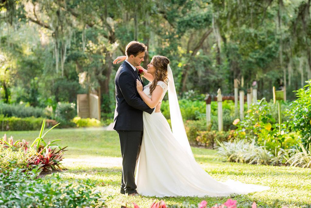 Florida Bride and Groom Garden Outdoor Wedding Portrait, Bride in Lace and Chiffon A-Line High Neckline Wedding Dress, Groom in Navy Blue Suit | Rustic Tampa Wedding Venue Kathleen's Garden