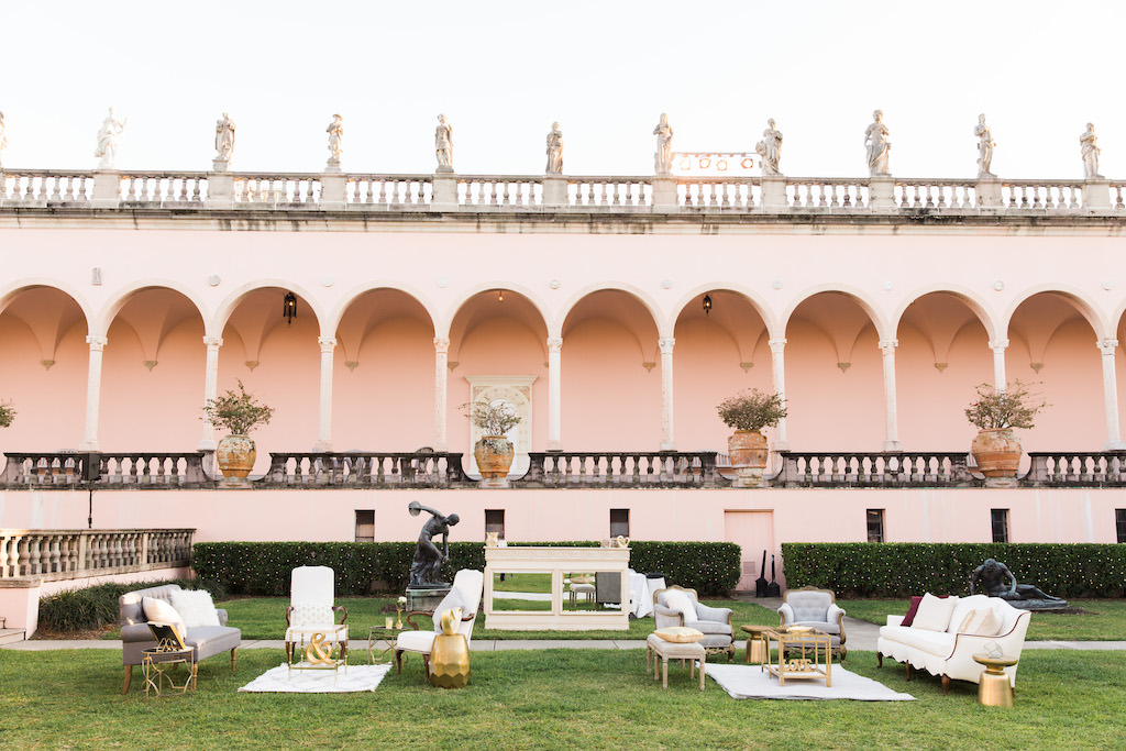 Outdoor Garden Courtyard Wedding Cocktail Decor, Loveseats and Vintage Chair, Gold Cocktail and Side Tables, Ivory and Mirror Bar | Sarasota Wedding Venue Ringling Museum | Tampa Bay Wedding Planner NK Weddings