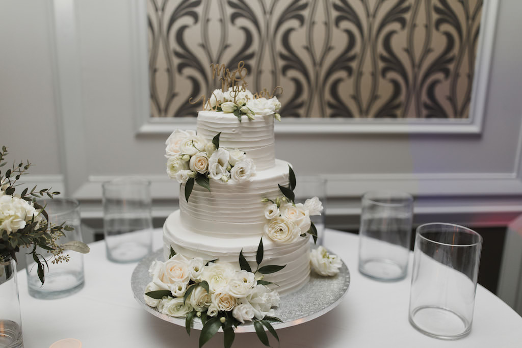 Three Tier White Ruffle Wedding Cake Decorate With Real White And