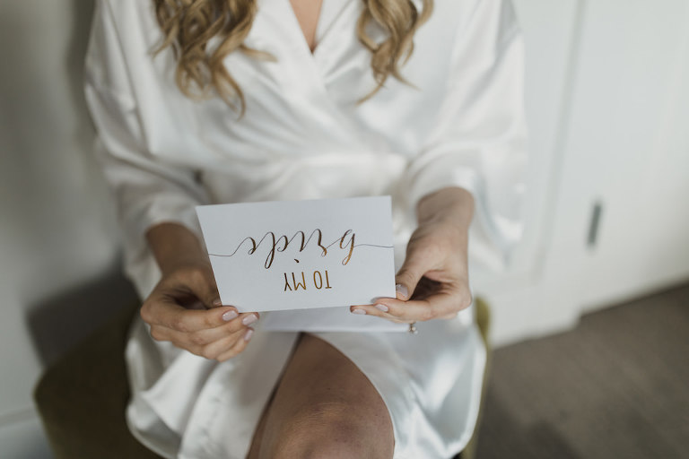 Florida Bride Getting Ready Wedding Portrait Reading Gold Foil Card From Groom