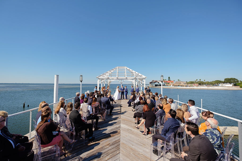 Waterfront Pier Wedding Ceremony Bride and Groom Wedding Portrait | Waterfront Island Inspired Wedding Venue The Godfrey Hotel and Cabanas Tampa | Tampa Bay Wedding Photographer Marc Edwards Photographs