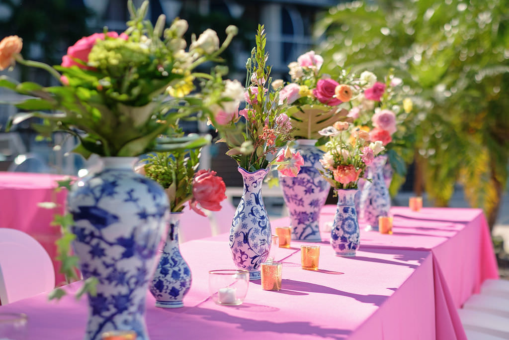 White and Blue Porcelain Vases with Citrus Colored Pink, Yellow, and Greenery Florals, Bright Pink Tablecloth and Gold Mercury Candle Votives | Tampa Bay Rental Company Kate Ryan Event Rentals | Tampa Bay Wedding Photographer Marc Edwards Photographs