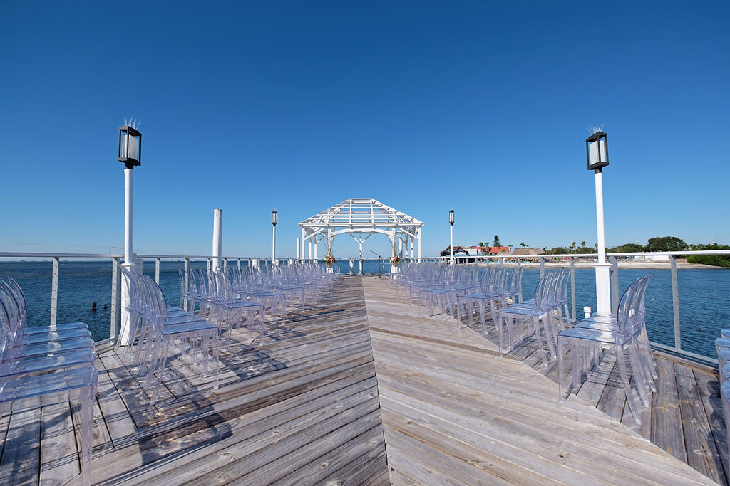 Waterfront Island Inspired Wedding Ceremony with Ghost Chairs| Venue The Godfrey Hotel and Cabanas Tampa | Tampa. Bay Wedding Photographer Marc Edwards Photographs | Chair Rentals Kate Ryan Event Rentals