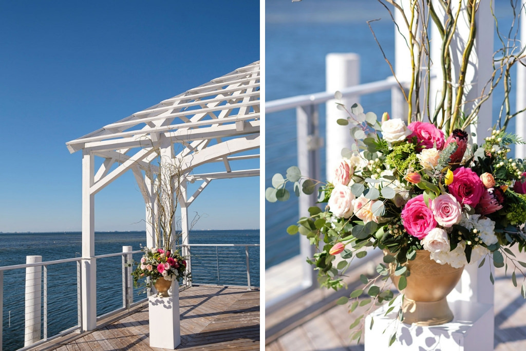 Citrus Inspired Wedding Ceremony Decor, White Pedestals with Bright Pink, Ivory and Greenery Floral Bouquets in Gold Vases | Waterfront Island Inspired Wedding Venue The Godfrey Hotel and Cabanas Tampa | Tampa. Bay Wedding Photographer Marc Edwards Photographs