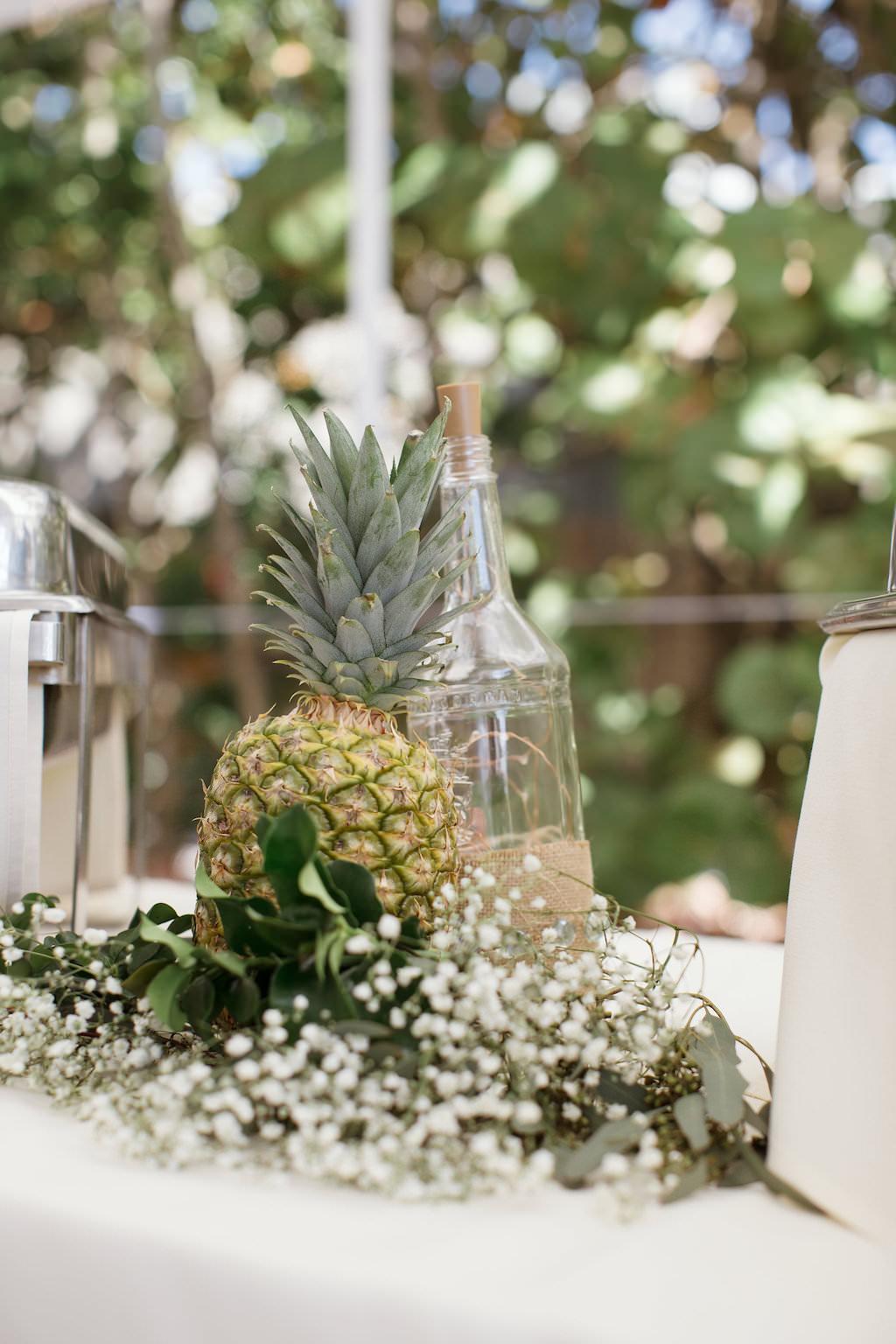 Tropical Inspired Wedding Reception Decor, Pineapple, White Baby's Breathe, Empty Wine Bottle Centerpiece