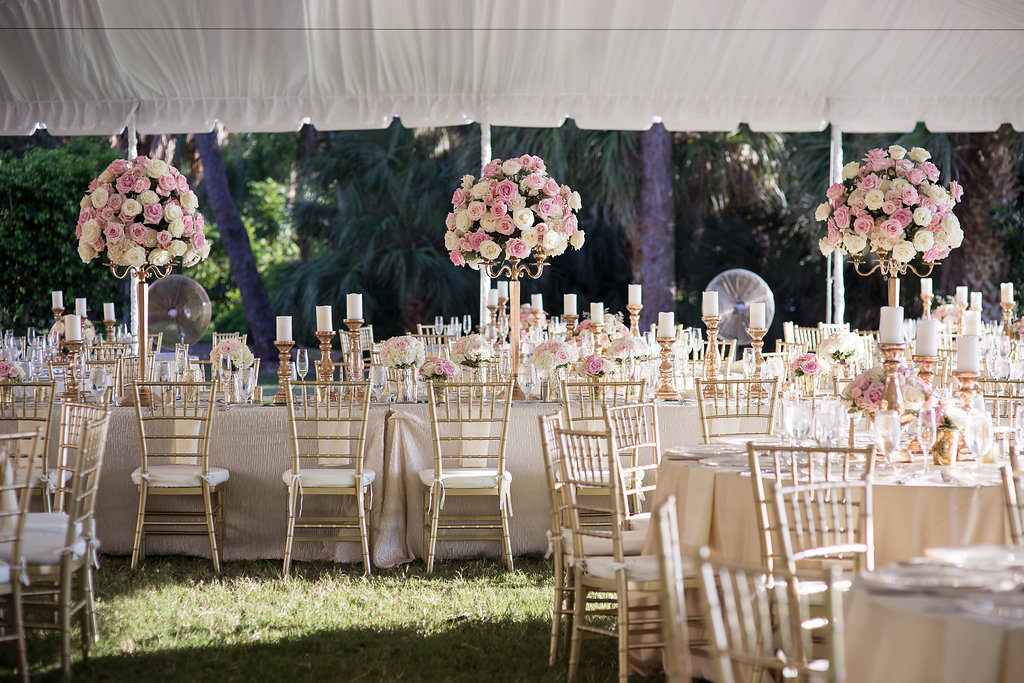Florida Outdoor Tent Wedding Reception Decor, Round Tables, Gold Chiavari Chairs and Tall Blush Pink and White Floral Centerpieces, Long Feasting Table with Gold Candlesticks and Tall Floral Centerpieces | Tampa Bay Wedding Photographer Cat Pennenga Photography | Sarasota Wedding Venue Powel Crosley Estate | Wedding Planner NK Productions
