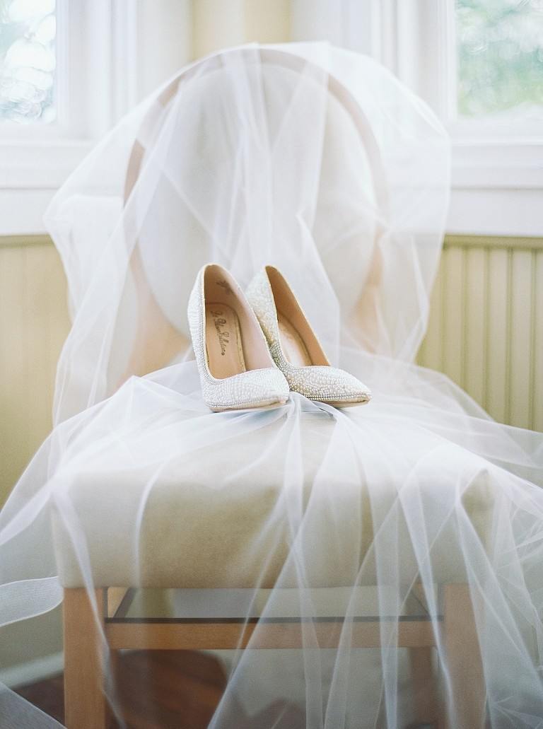 Wedding Veil Draped Over Chair and Pearl Embellished Pointed Toe Wedding Shoes