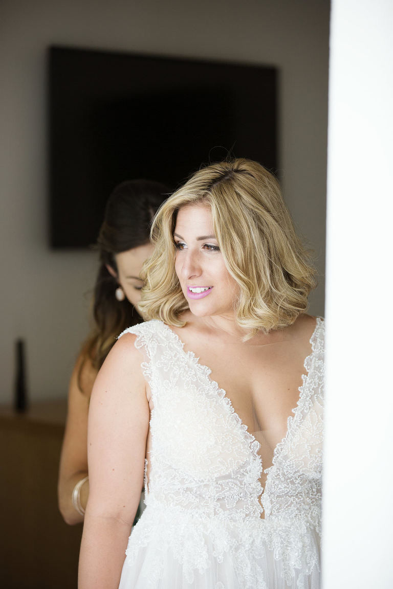 Florida Bride Getting Ready Wedding Portrait in Deep V-Neckline Lace Tank Top Strap Wedding Dress | Tampa Bay Bridal Boutique Truly Forever Bridal