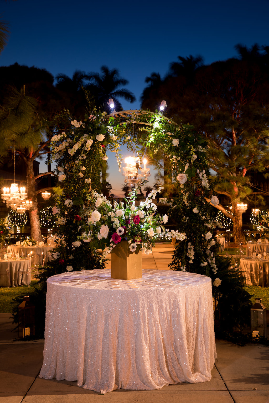 Nighttime Wedding Outdoor Garden Courtyard Wedding Reception Decor, Round Table with Glitter Blush Pink Linen, Gold Vase with Whimsical Organic Garden Greenery, Ivory, White, Red Floral Centerpiece | Sarasota Wedding Venue Ringling Museum | Tampa Bay Wedding Planner NK Weddings