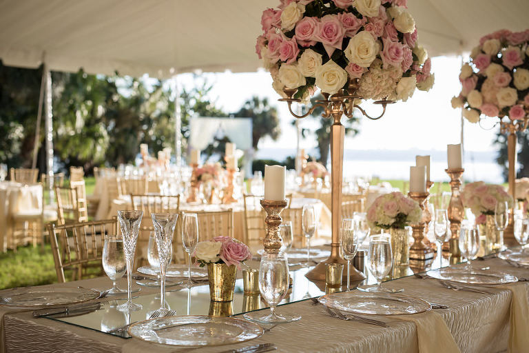 Florida Outdoor Tent Wedding Reception Decor, Long Feasting Table with Gold Tablecloth, Tall Gold Candlestick with Blush Pink and White Floral Bouquets, Gold Mercury Candlestick Holders | Tampa Bay Wedding Photographer Cat Pennenga Photography | Wedding Planner NK Productions