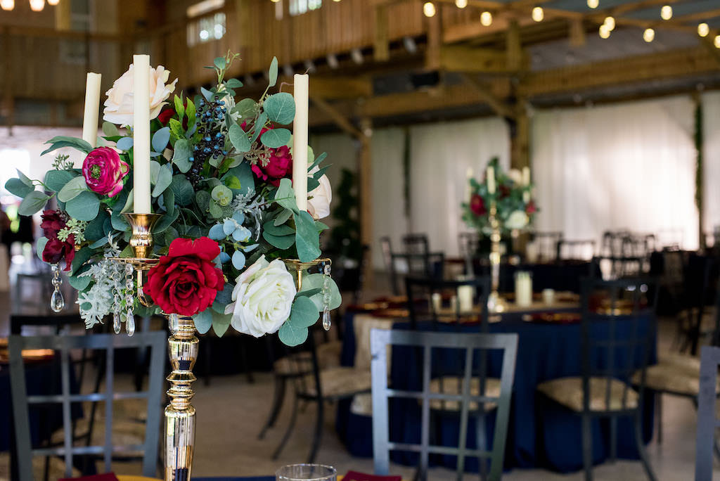 Rustic Wedding Reception Decor, Tall Silver Candlestick with Greenery, Red, Burgundy, Ivory Florals, Candles and Hanging Crystals Centerpiece