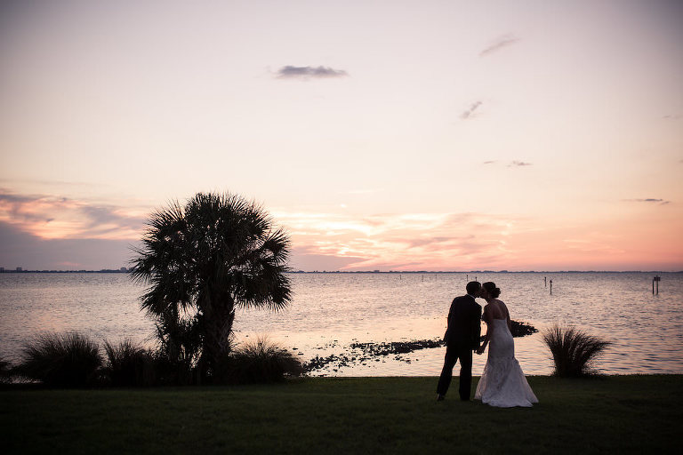 Florida Bride and Groom Outdoor Waterfront Sunset Wedding Portrait | Sarasota Wedding Photographer Cat Pennenga Photography | Planner NK Productions