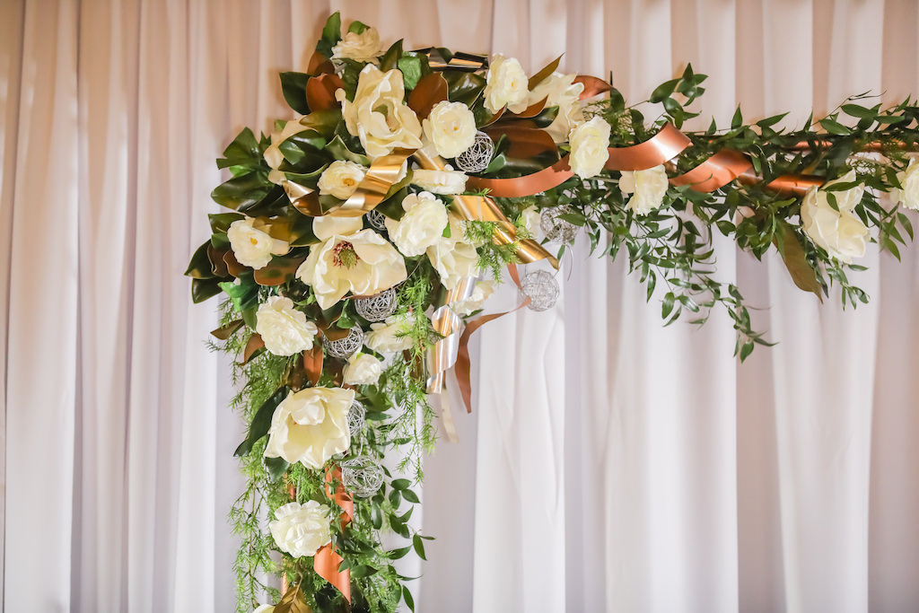 Industrial Inspired Wedding Reception Decor, White and Greenery Florals on Bronze Metal Arch with White Draping Backdrop   Tampa Bay Wedding Photographer Lifelong Photography Studios   Wedding Rentals A Chair Affair