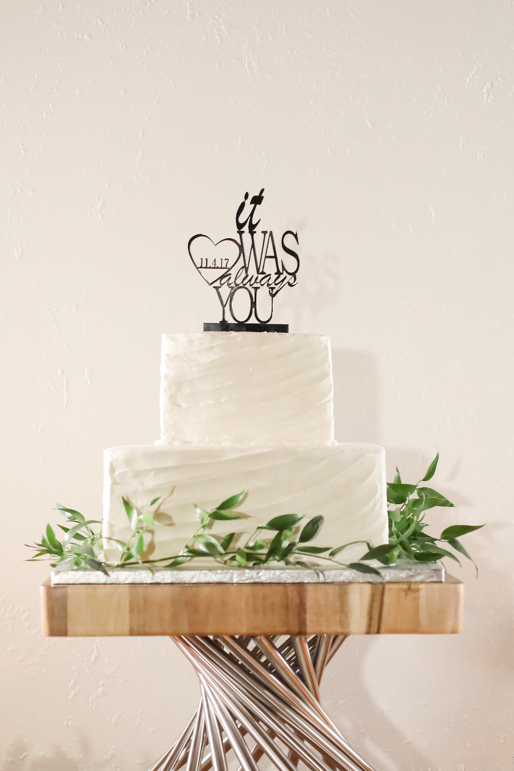 Two White Tier Wedding Cake with Greenery Wreath and Black Laser Cut Cake Topper   Tampa Bay Wedding Photographer Lifelong Photography Studios   Wedding Rentals A Chair Affair