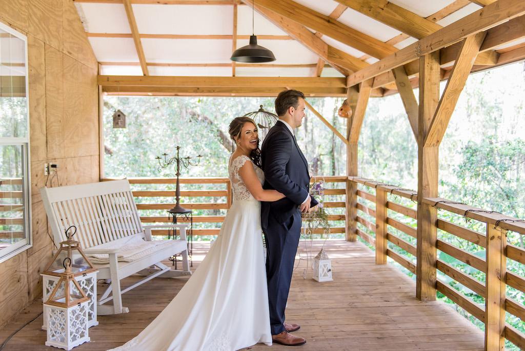 Bride and Groom Creative Wedding Portrait, Bride Hugging Groom from Behind | Rustic Tampa Wedding Venue Kathleen's Garden