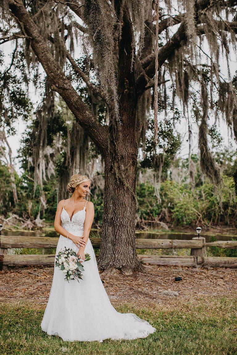 Outdoor Rustic Inspired Bride Wedding Portrait in Spaghetti Strap, V Neck Lace A Line Wedding Dress | Lakeland Rustic Wedding Venue The Prairie Glenn Barn at Gable Oaks Ranch