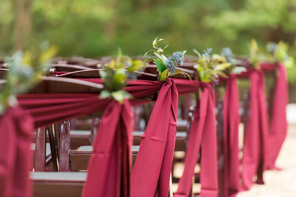Outdoor Rustic Wedding Ceremony Decor, Wooden Chairs with Burgundy Sashes and Lilac and Greenery Floral Decor