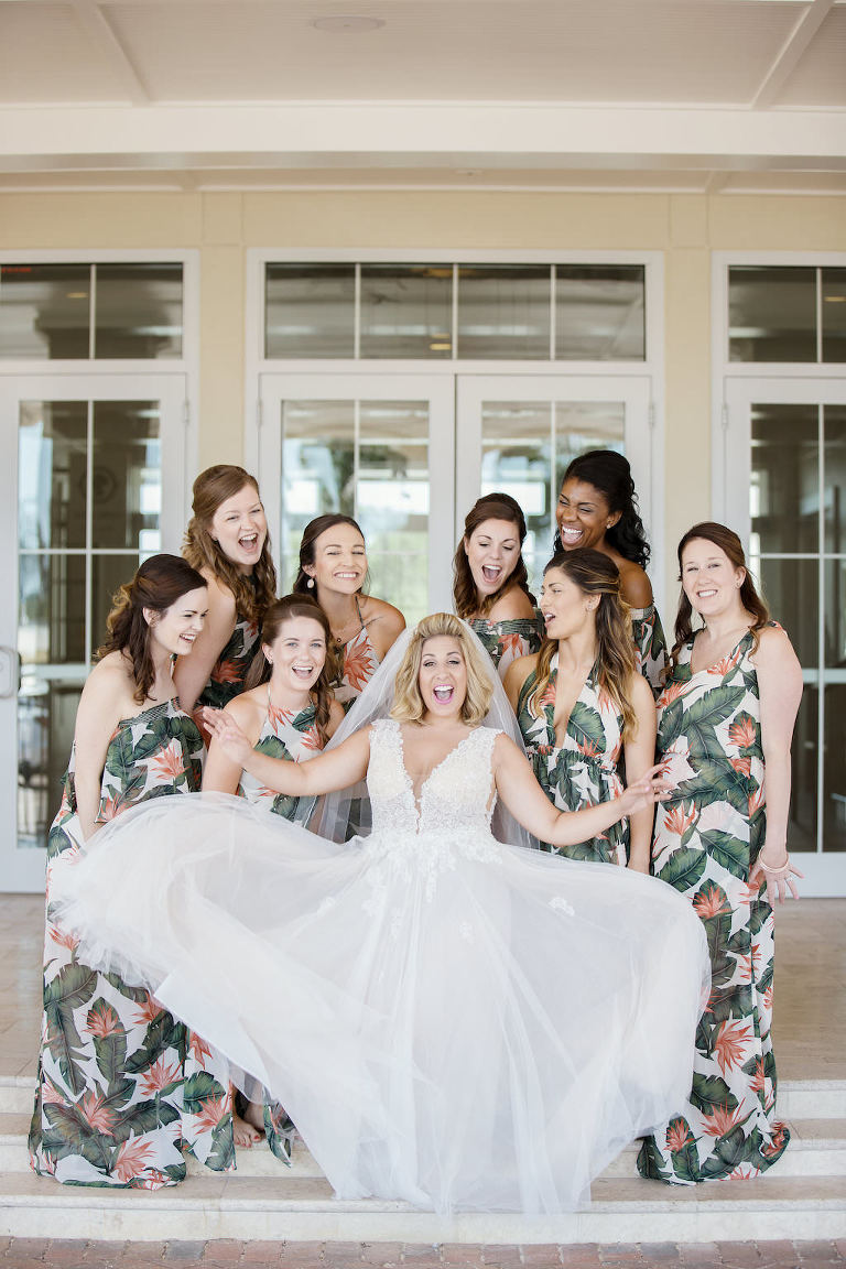 Florida Bride and Bridesmaids Wedding Portrait, Bridesmaids in Tropical Floral Long Matching Dresses, Bride in V Neckline Lace Tank Top Strap Wedding Dress | Tampa Bay Bridal Boutique Truly Forever Bridal